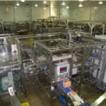 Smurfit Kappa Case Packing Machine with Case & Lid Erectors