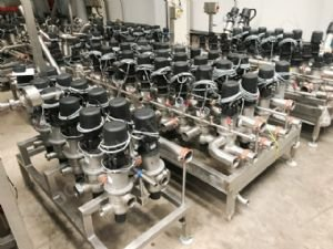 Various APV Actuated Multi-Port Valves with Control Heads